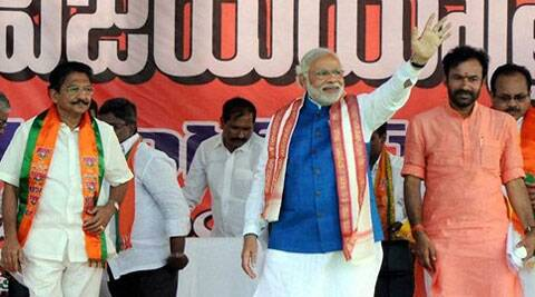 BJP prime ministerial candidate Narendra Modi at an election campaign rally in Nizamabad on Tuesday. (PTI)