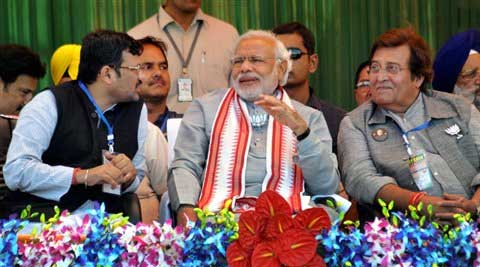 BJP PM candidate Narendra Modi with party candidate Vinod Khanna during an election rally in Pathankot on Friday. (PTI)