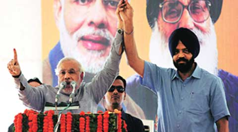 Modi with Manpreet Singh Ayali at a rally in Ludhiana on Friday.