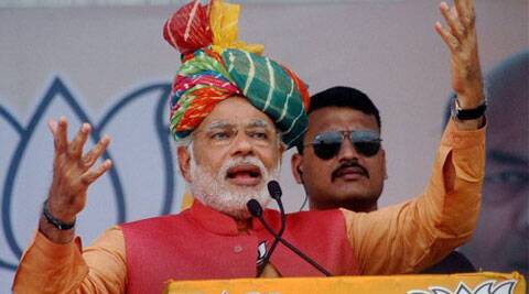 BJP's PM candidate Narendra Modi addresses an election campaign rally in Anand on Monday. (PTI Photo)
