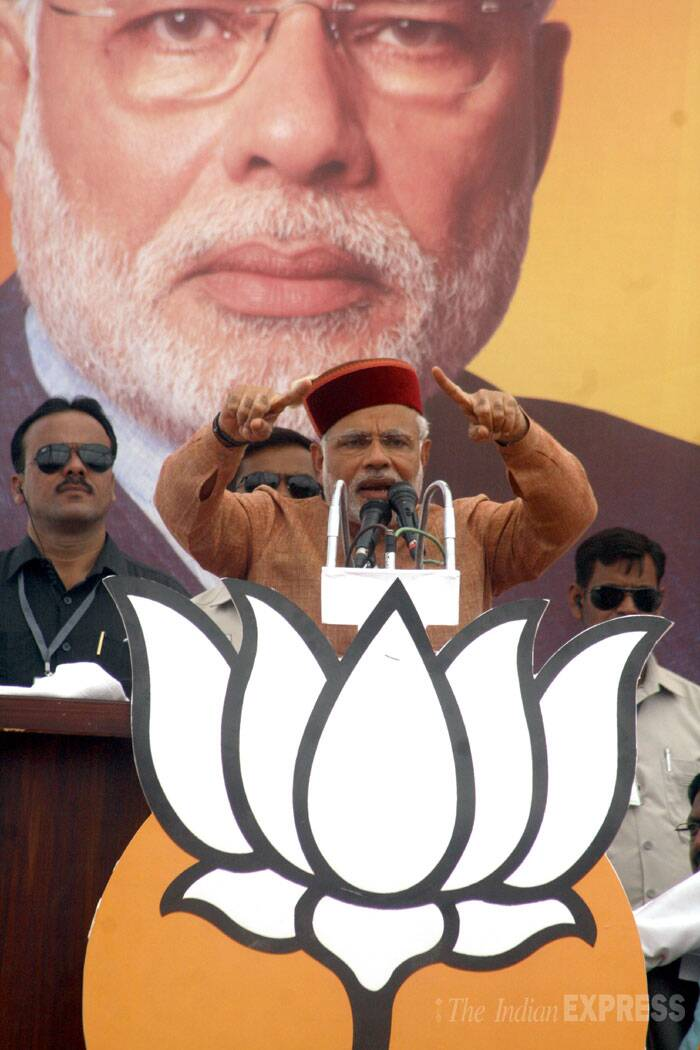 "Amid escalating war of words, Narendra Modi on Tuesday alleged that Congress was a ""dhokebaaz"" (fraud) party and described its manifesto as ""dhokapatra"". <br /> BJP PM candidate Narendra Modi during an election rally in Palampur, Himachal Pradesh on Tuesday. (IE Photo: Lalit Kumar)"