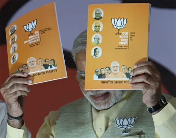 BJP unveils poll manifesto, promises inclusive growth