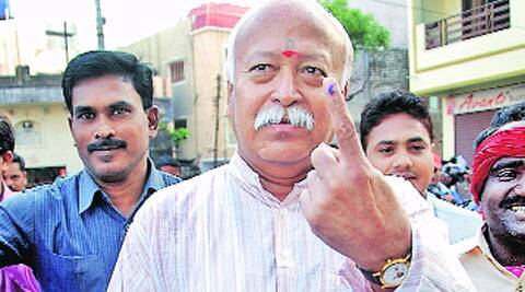 RSS chief Mohan Bhagwat shows his inked finger after casting his vote in Nagpur. (Sudarshan Sakharkar)