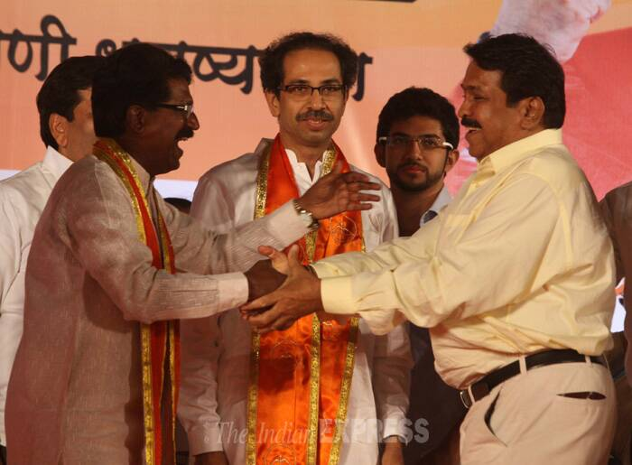 Mohan Rawle is greeted by Shiv Sena candidate Arvind Sawant as party president Udhav Thackery looks on during the rally at Girgoan, Mumbai. (IE Photo: Dilip Kagda)
