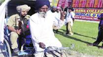 Candidate Mohinder Singh gives his guard a ride.