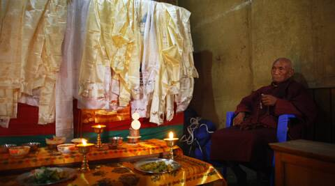A Buddhist monk performs rituals next to a casket containing the dead body of Nepalese mountaineer Ang Kaji Sherpa, killed in an avalanche on Mount Everest, offer prayers at the Sherpa Monastery in Katmandu. (AP)