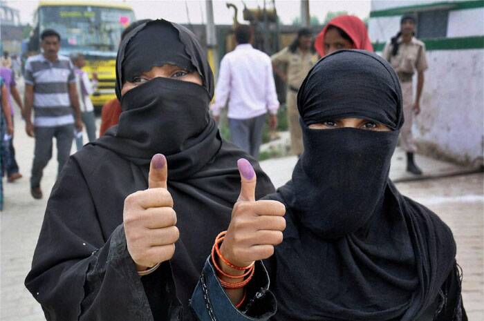 Muslim women show ink marked finger after casting their vote for Lok Sabha election in Moradabad, UP on Thursday. (PTI)