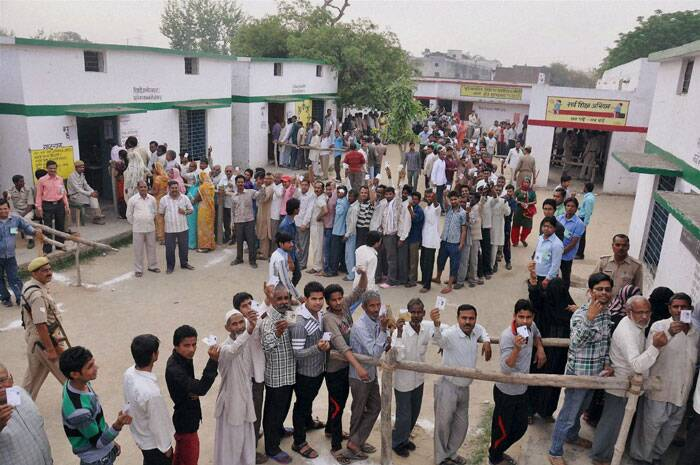 Voters stand in queue to cast their vote for Lok Sabha elections in Moradabad, Uttar Pradesh on Thursday. (PTI)