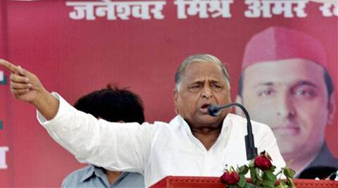 Samajwadi Party chief Mulayam Singh Yadav addresses an election campaign meeting in Agra on Wednesday. (PTI)
