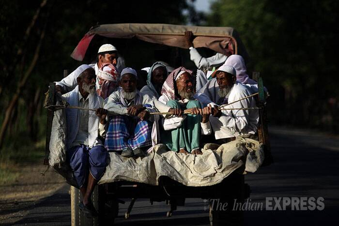 Muslim men ride a tonga to reach an election rally in Moradabad, Uttar Pradesh. (IE Photo: Tashi Tobgyal)