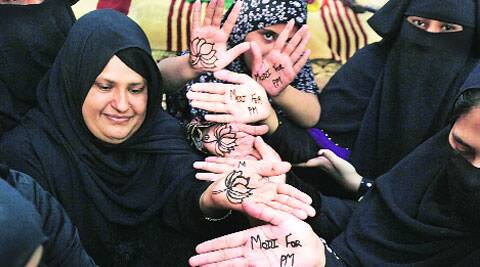 Women apply heena on their hands on the occasion of BJP's foundation day in Ahmedabad on Sunday. (Javed Raja)