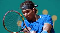 Rafael Nadal, Roger Federer breeze into last eight