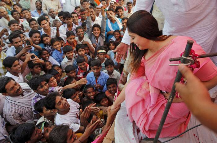 Nagma greets supporters at an election campaign rally by Mohammad Kaif party candidate. (AP)