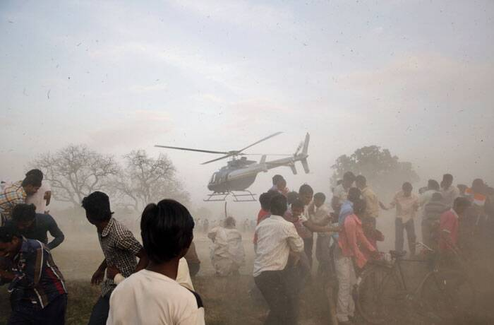A helicopter carrying Nagma, Bollywood actress and Congress party candidate from Meerut takes off after an election rally by party candidate Mohammad Kaif from Phulpur, in Soraon area, Allahabad. (AP)