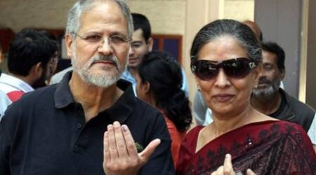 Lt Guv of Delhi Najeeb Jung along with his wife show ink marked finger after casting their vote for Lok Sabha election in New Delhi on Thursday.