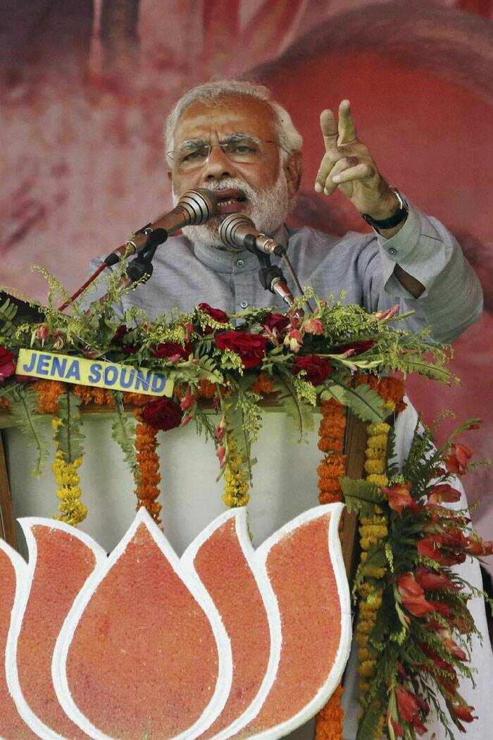 Bharatiya Janata Party's prime ministerial candidate Narendra Modi addresses his supporters during a campaign rally at Balasore near Bhubaneswar. (PTI)