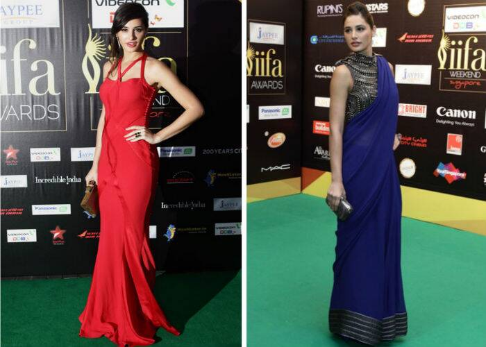 Nargis Fakhri was strikingly beautiful in a red Dior gown at the 2012 IIFA Awards in Singapore. She donned a beautiful blue Anikka sari with a metal blouse for the IIFA Rocks that year.