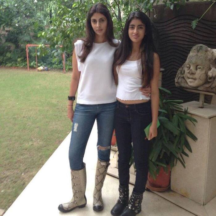 Mother and daughter duo – Shweta and Navya pose together in white tops and denims.
