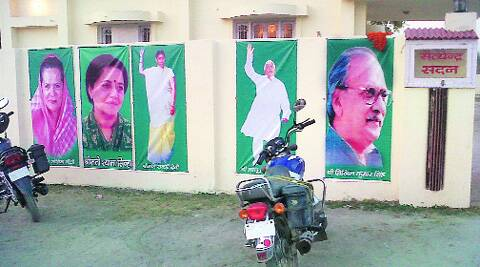 On Congress nominee's walls, Lalu and Rabri alongside Sonia.Express