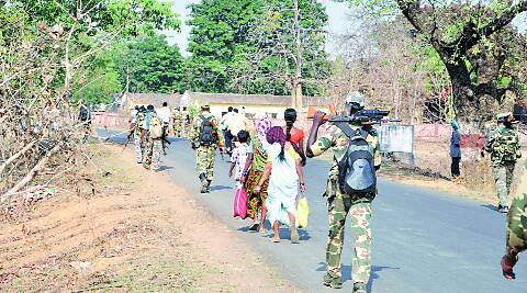 Security forces walk a street in Gadchiroli. (IE)