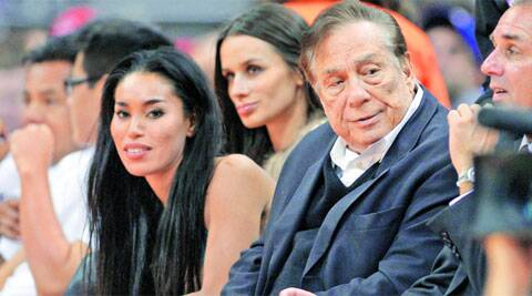 Donald Sterling, the owner of the Los Angeles Clippers, was allegedly caught on tape making racist comments while speaking to his partner V Stiviano (L).