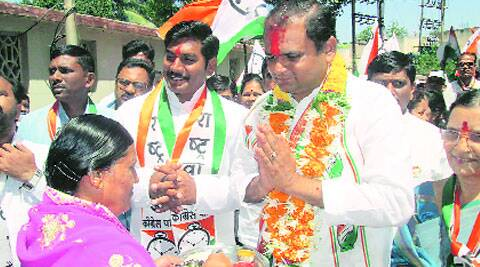 The NCP candidate greets voters during a padyatra.