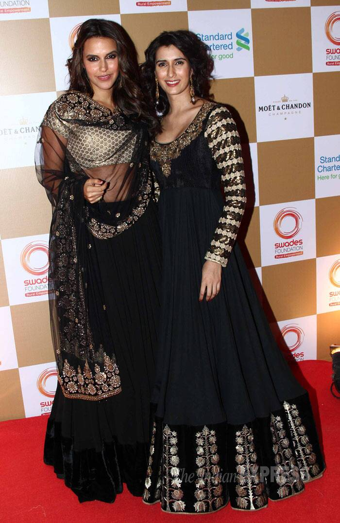 Neha Dhupia was gorgeous in a black and gold lehenga as she posed with a friend on the carpet. (Photo: Varinder Chawla)