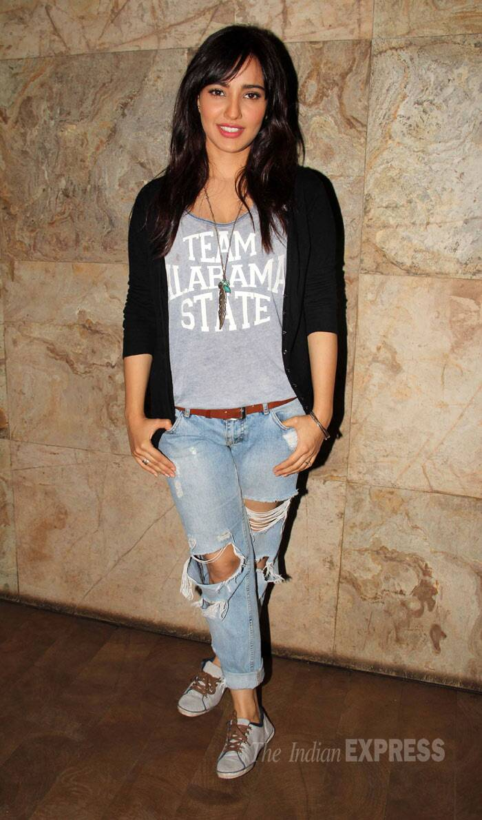 Neha Sharma was cute in a T shirt with a pair of distressed jeans, a cardigan and sneakers. (Photo: Varinder Chawla)