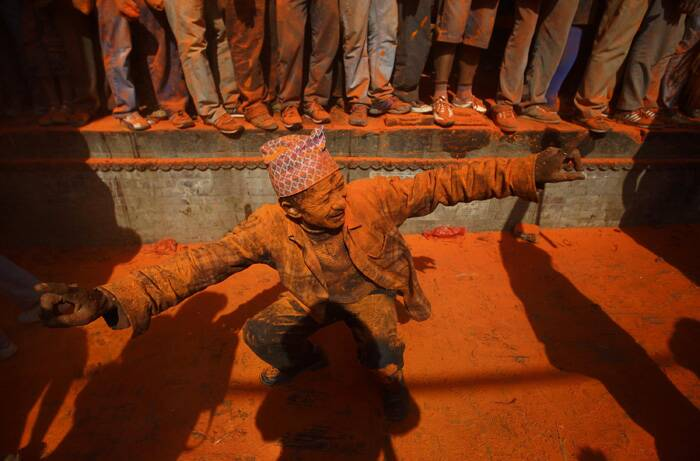"The calendar was introduced by Nepal's Shah Kings, believed have migrated from India to Nepal during the middle age.<br />A devotee sings and dances to the beat of traditional instruments while celebrating the ""Sindoor Jatra"" near Kathmandu. (Reuters)"