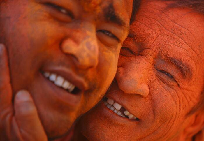 Devotees whose faces are smeared with vermillion powder pose for a picture while celebrating the 'Sindoor Jatra' vermillion powder festival in Thimi, near Kathmandu. (Reuters)