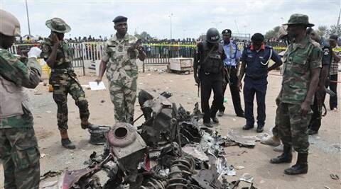 At least 71 persons were killed when an explosion blasted through a busy commuter bus station on the outskirts of Nigeria's capital, Abuja on Monday.