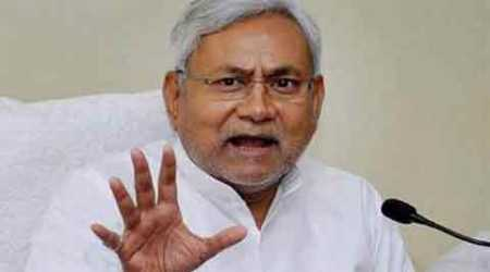 In an embarrassment for Nitish Kumar, a fugitive murder accused presided over his election rally and was arrested later, said police.