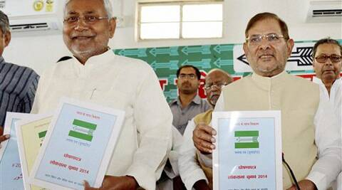 Bihar Chief Minister Nitish Kumar with party President Sharad Yadav release party manifesto in Patna on Saturday. (PTI Photo)