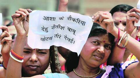 A woman holds up a placard at the rally Monday. Ravi S Sahani