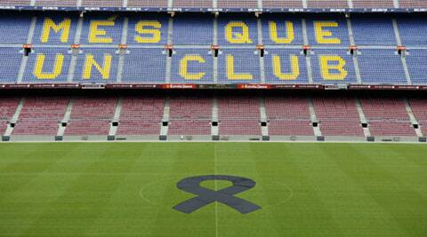 A black ribbon is seen on the pitch during a memorial to Tito Vilanova at Camp Nou stadium in Barcelona on Saturday. (Reuters)