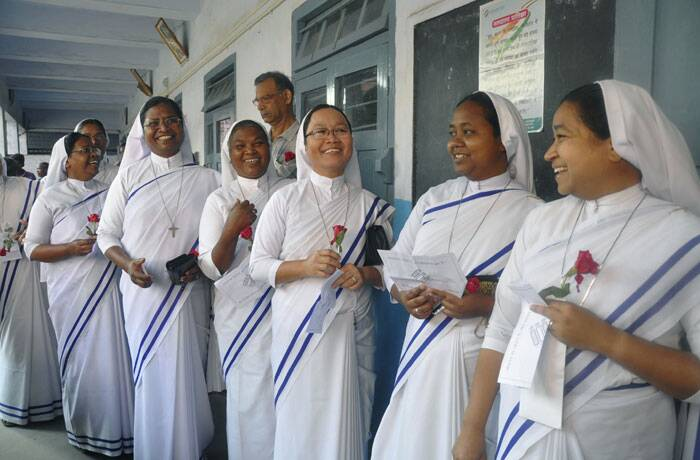 Catholic nuns stand in a queue to cast their votes in Ranchi, Jharkhand on Thursday. <br /> The multiphase voting across the country runs until May 12, with results for the 543-seat lower house of Parliament announced May 16. (AP)