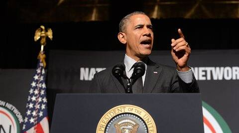 President Barack Obama gestures while speaking at the National Action Network conference on Friday. (AP)