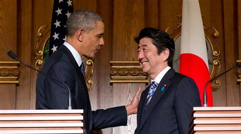 US Barack Obama, left, and Japanese Prime Minister Shinzo Abe shake hands at the conclusion of their joint news conference at the Akasaka State Guest House in Tokyo. (AP)