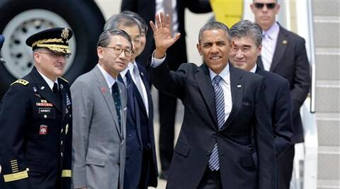 U.S. President Barack Obama waves upon his arrival for two-day visit at Osan Air Base in Pyeongtaek, south of Seoul, South Korea on Friday. (AP)