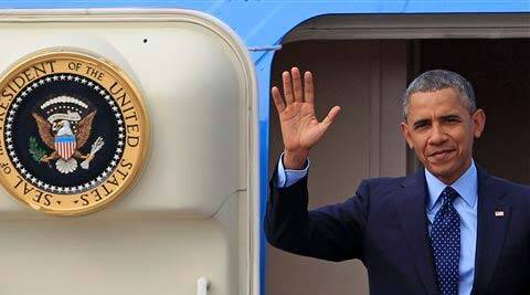 US President Barack Obama waves from the doorway of Air Force One upon his arrival in Malaysia on Saturday. (AP)