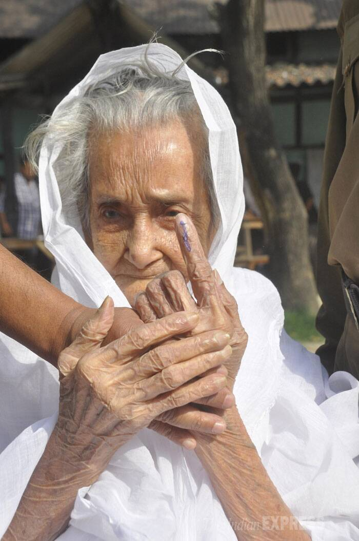 An old woman shows her inked finger after casting her vote for Lok Sabha elections at a polling station, in Guwahati on Thursday. (IE Photo: Dasarath Deka)