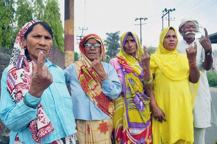 Women voters show their ink marked fingers after casting votes for Lok Sabha elections in Moradabad, Uttar Pradesh on Thursday. (PTI)