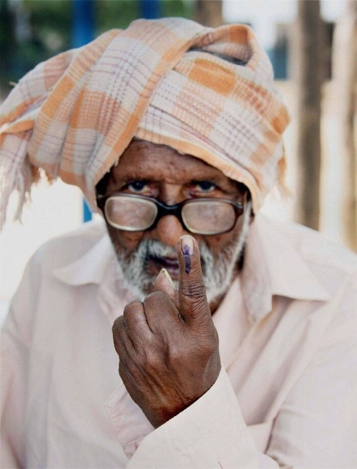 An old man showing his inked finger after casting his vote in Coimbatore on Thursday. (PTI)