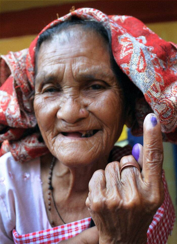 Polling for two Lok Sabha seats in Meghalaya began on a peaceful note in the second phase of the election on Wednesday (April 9). <br /> An old lady showing her finger mark  after casting  her vote during polling at Ri Bhoi District in  Meghalaya on Wednesday. (PTI)