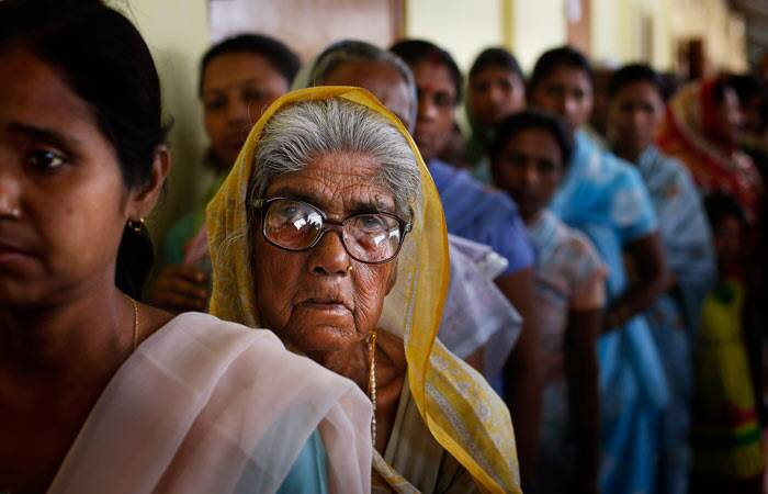 Prominent contestants whose fates were sealed in EVMS were union ministers and Congress nominees Paban Singh Ghatowar (Dibrugarh) and Ranee Narah (Lakhimpur), besides former union minister and sitting Congress MP Bijoy Krishna Handique (Jorhat). <br /><br /> An elderly woman watches as she stands in a queue to cast her vote during the first phase of elections in Dibrugarh, in Assam. (AP)