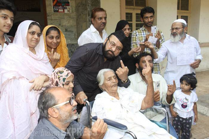 A 111 year old woman, Sayyad Mareabai Umer with her five generation family pose together after casting their votes at M M Sonawala Peoples School in Khar on Thursday. (IE Photo: Dilip Kagda)