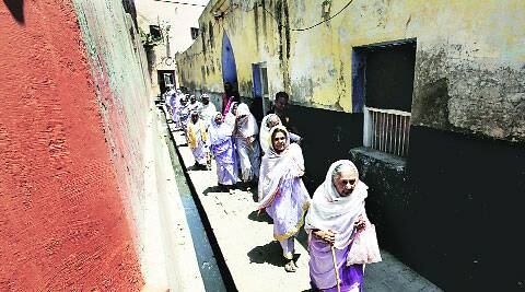Widows on the way to casting their votes in Vrindavan Thursday.   Ravi Kanojia