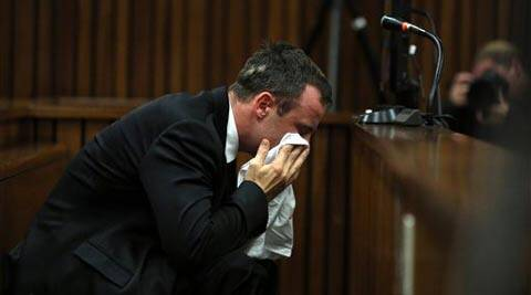 Oscar Pistorius weeps as he listens to evidence by a pathologist in court in Pretoria, South Africa, Monday (AP)