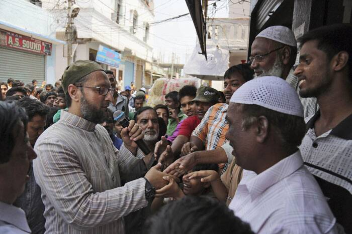 All India Majlis Ittehadul Muslimeen (AIMIM) president Asaduddin Owaisi, center, contesting in the parliamentary elections speaks during his campaign in Hyderabad on Friday. (AP)