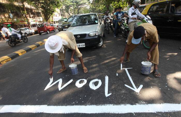 BMC workers marking near the polling station before the code of conduct starts at Dadar on Tuesday. Express photo by Prashant Nadkar.